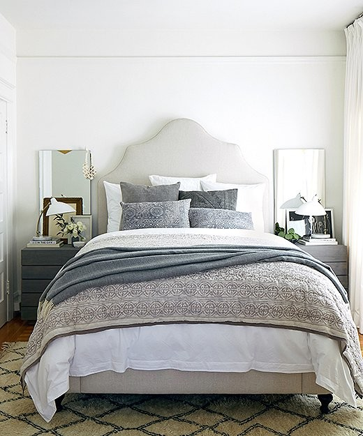 Example of a mid-sized transitional master medium tone wood floor bedroom design in San Francisco with white walls and no fireplace