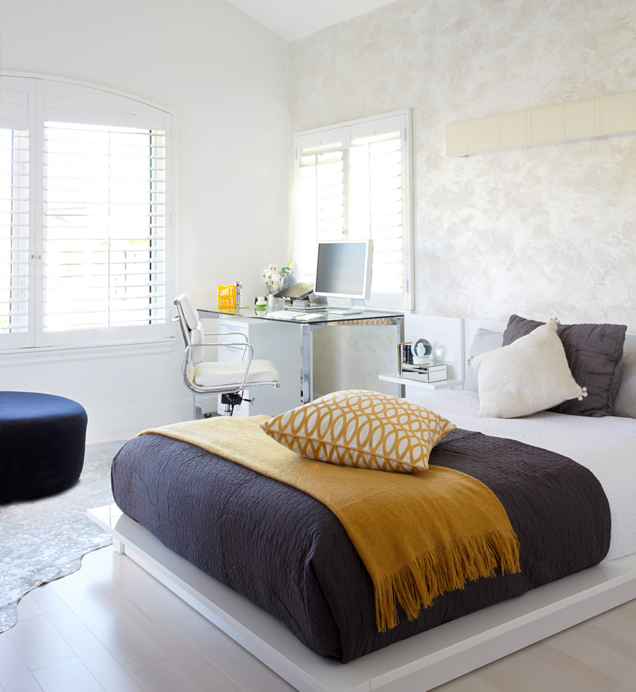 Inspiration for a mid-sized contemporary guest light wood floor and gray floor bedroom remodel in Orange County with multicolored walls