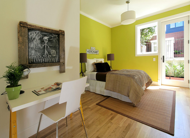 Contemporary bedroom in San Francisco with green walls, medium hardwood flooring and no fireplace.