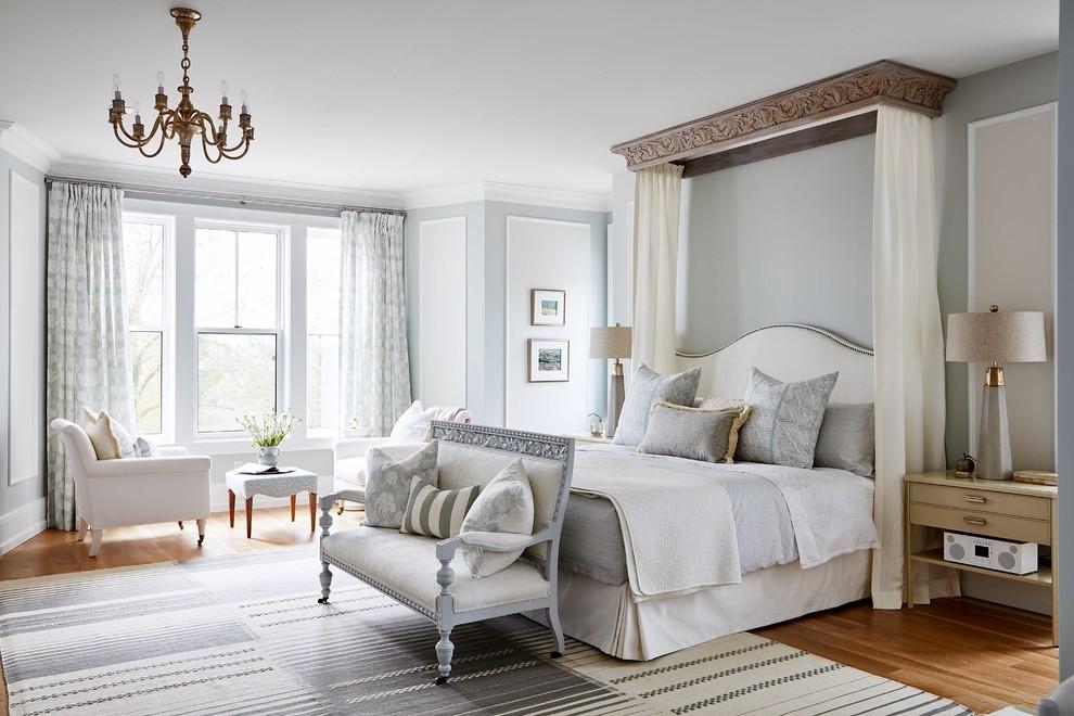 Bedroom - farmhouse medium tone wood floor bedroom idea in Toronto with blue walls