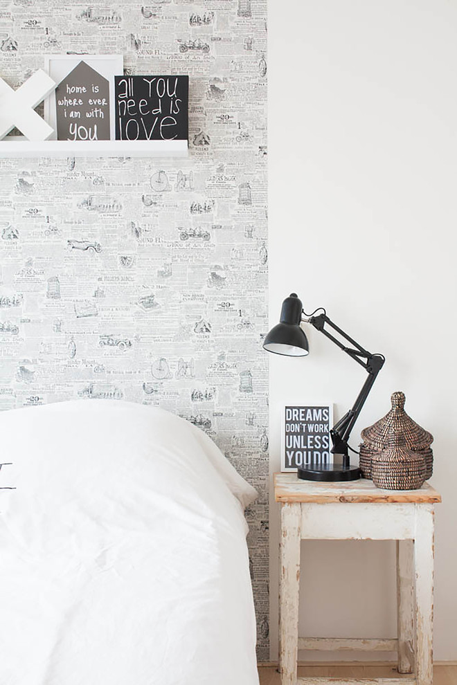Example of a danish bedroom design in Amsterdam with white walls