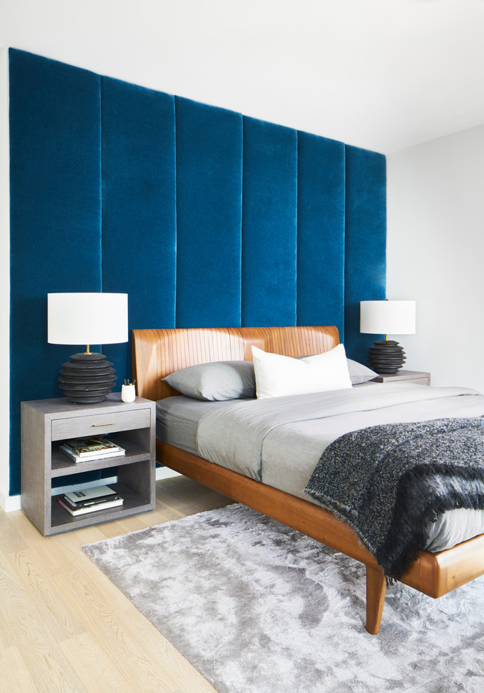 Inspiration for a contemporary guest light wood floor and beige floor bedroom remodel in Austin with blue walls