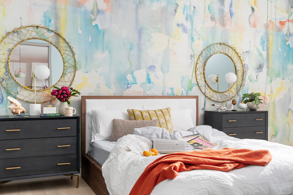 Mid-sized eclectic light wood floor and beige floor bedroom photo in Boston with multicolored walls