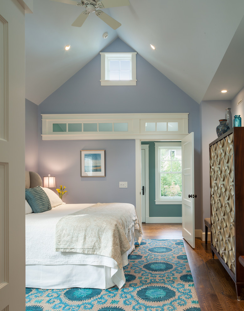 Transitional medium tone wood floor bedroom photo in Providence with blue walls