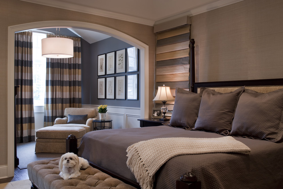 Example of a classic master bedroom design in Chicago with brown walls