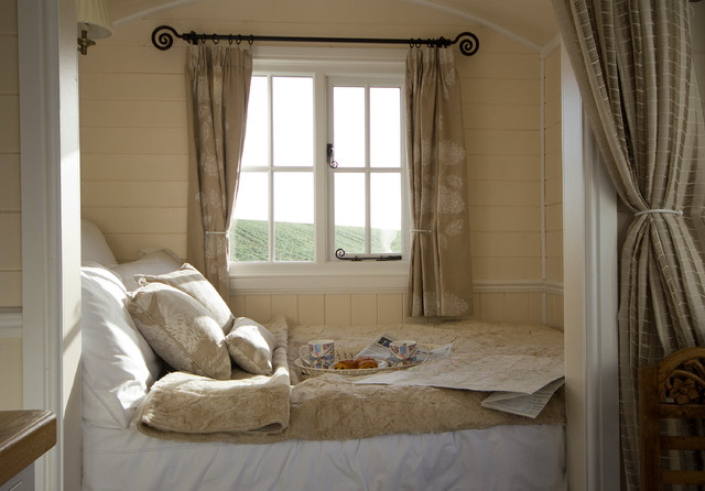 Small farmhouse bedroom idea in Other with beige walls. Bedroom Curtain Ideas   Houzz