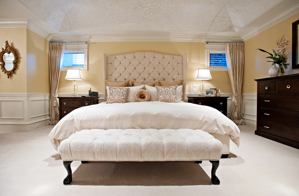 Bedroom - large traditional master carpeted and white floor bedroom idea in Vancouver with yellow walls