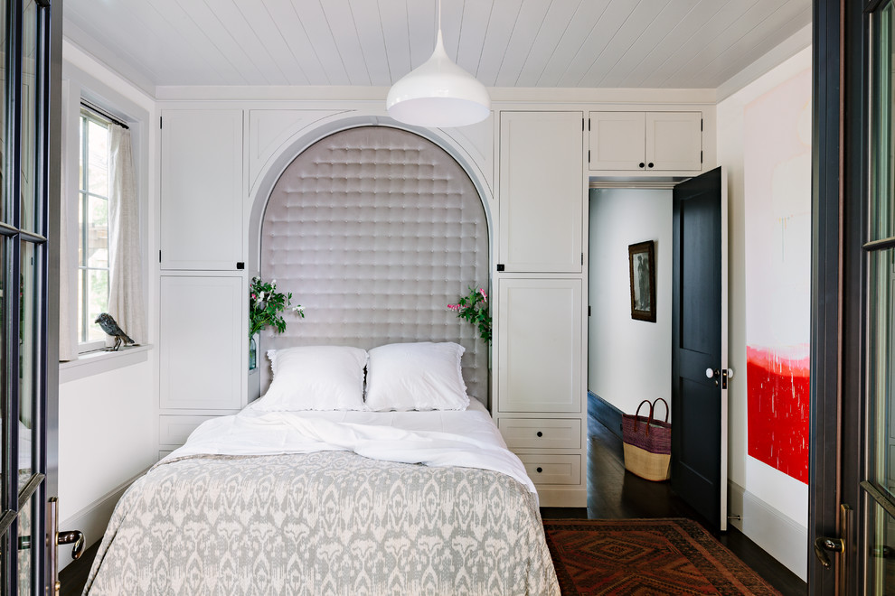 Inspiration for a transitional master dark wood floor bedroom remodel in Portland with white walls