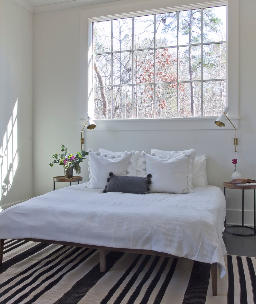 Bedroom - mid-sized scandinavian loft-style concrete floor bedroom idea in Atlanta with white walls and no fireplace