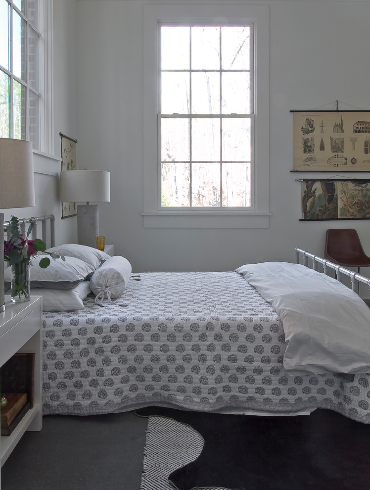 Example of a mid-sized danish loft-style concrete floor bedroom design in Atlanta with white walls
