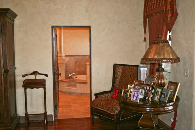 Mid-sized tuscan master dark wood floor bedroom photo in Austin with beige walls