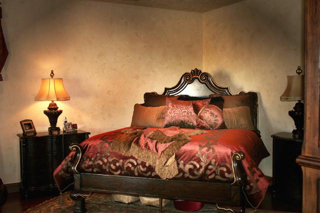 Bedroom - mid-sized mediterranean master dark wood floor bedroom idea in Austin with beige walls