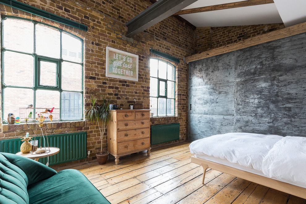 Example of a mid-sized urban master medium tone wood floor and beige floor bedroom design in London with no fireplace