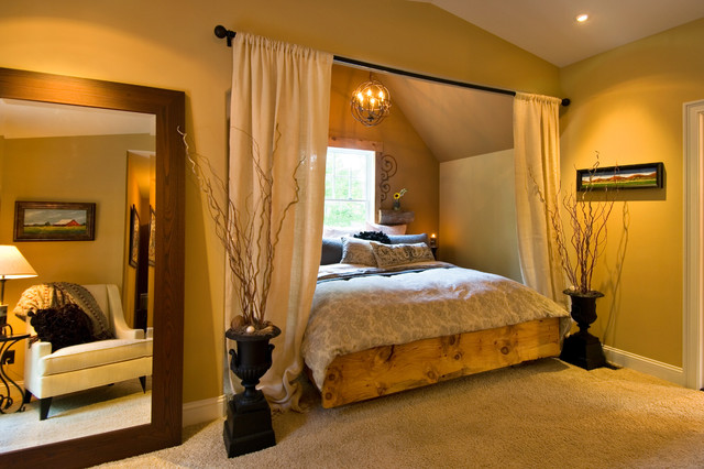 Example of a tuscan carpeted bedroom design in Boston