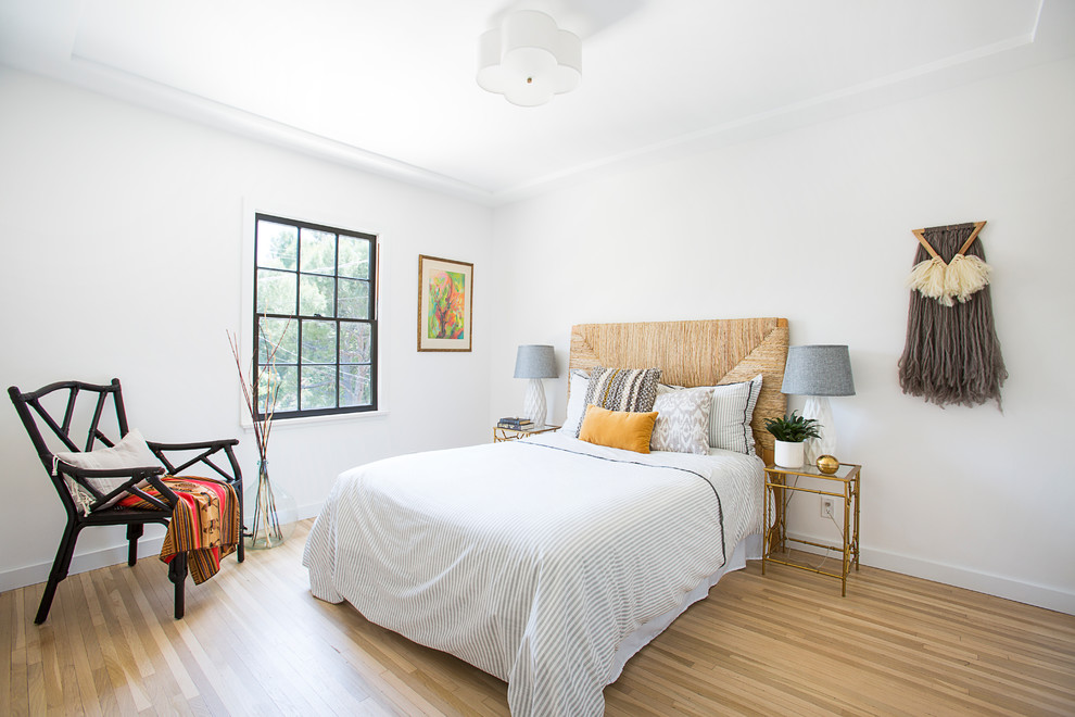 Large transitional master light wood floor and beige floor bedroom photo in Los Angeles with white walls