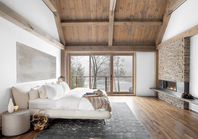 Simple And Chic Rustic Cabin Bedroom With Cozy Stone Fireplace