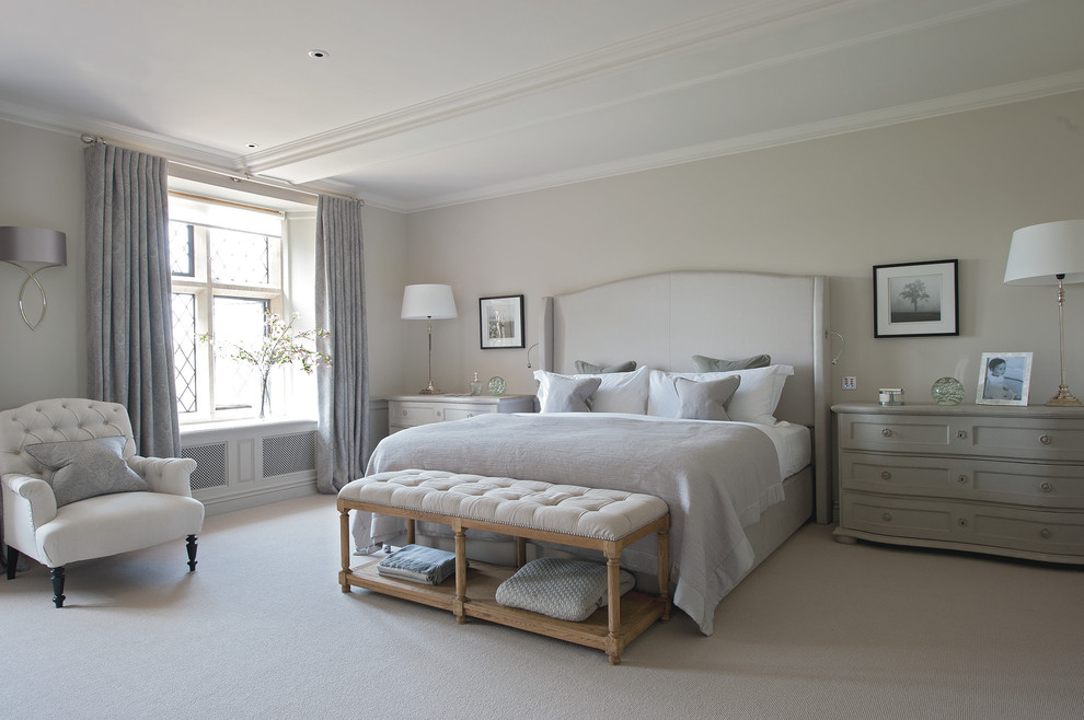 Design ideas for an expansive country master bedroom in Gloucestershire with carpet and grey walls.