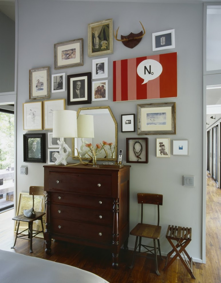 Inspiration for an eclectic bedroom remodel in New York with white walls
