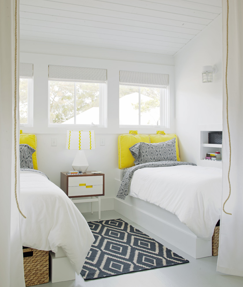 Example of a small transitional guest painted wood floor bedroom design in Atlanta with white walls