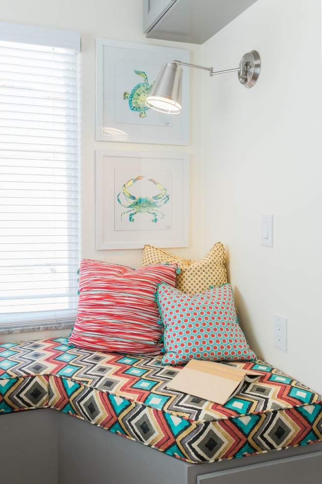 Small beach style guest vinyl floor and brown floor bedroom photo in San Diego with yellow walls