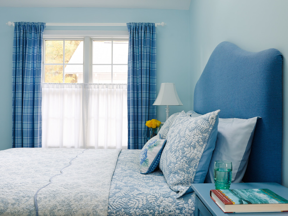 Inspiration for a coastal bedroom remodel in Chicago with blue walls