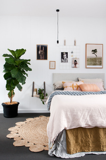 This is an example of a mid-sized scandinavian bedroom in Brisbane with white walls and carpet.