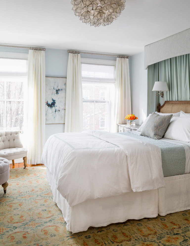 Bedroom - mid-sized traditional master medium tone wood floor bedroom idea in New York with blue walls and no fireplace