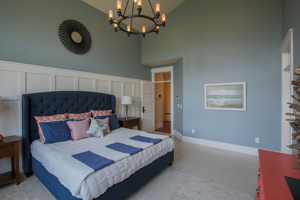 Inspiration for a large transitional master carpeted bedroom remodel in Salt Lake City with blue walls