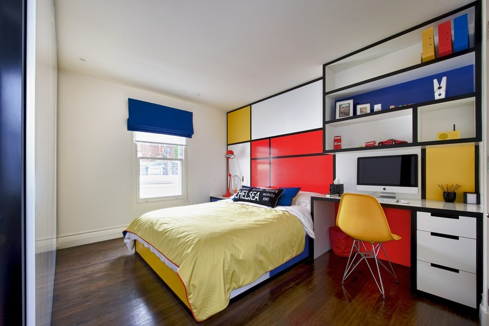 Example of a trendy dark wood floor bedroom design in London with multicolored walls