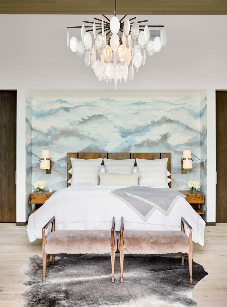 Inspiration for a mid-sized transitional master light wood floor and beige floor bedroom remodel in Denver with white walls
