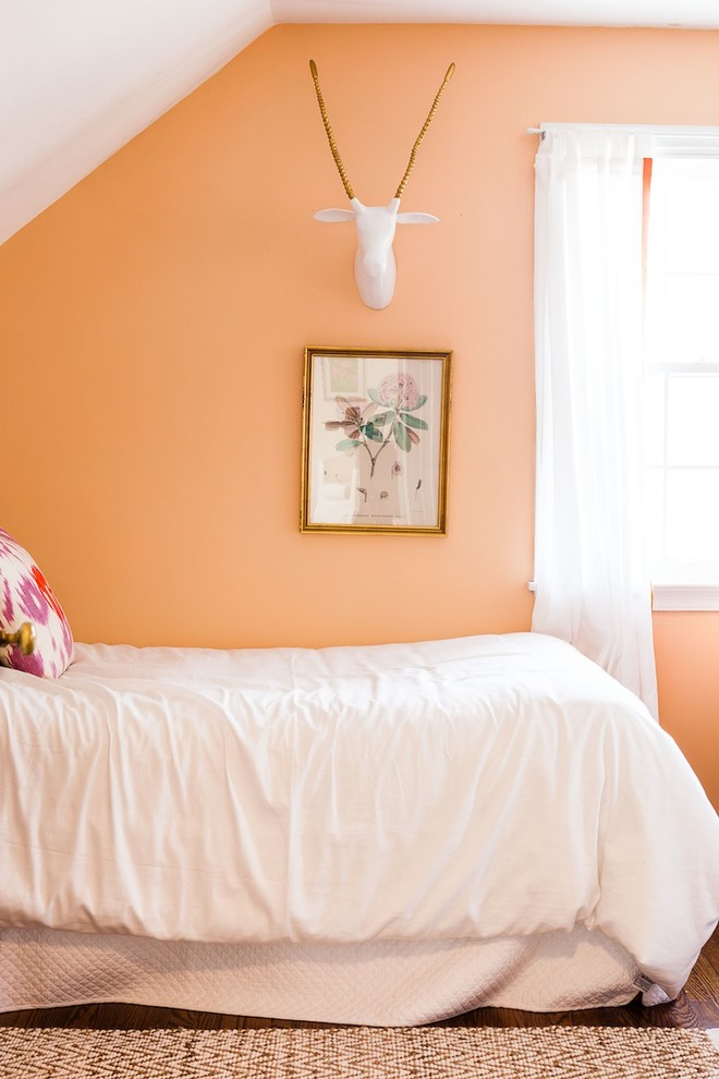 Inspiration for a transitional dark wood floor bedroom remodel in Philadelphia with orange walls