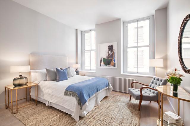 Bedroom - transitional medium tone wood floor bedroom idea in New York with white walls