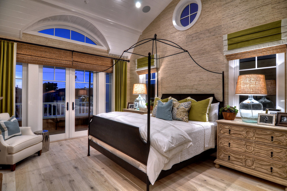 Example of a large trendy master light wood floor and brown floor bedroom design in Orange County with multicolored walls and no fireplace