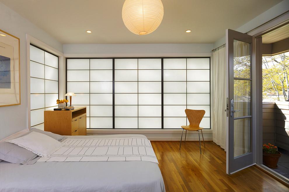 Bedroom - mid-sized modern master medium tone wood floor and brown floor bedroom idea in DC Metro with gray walls