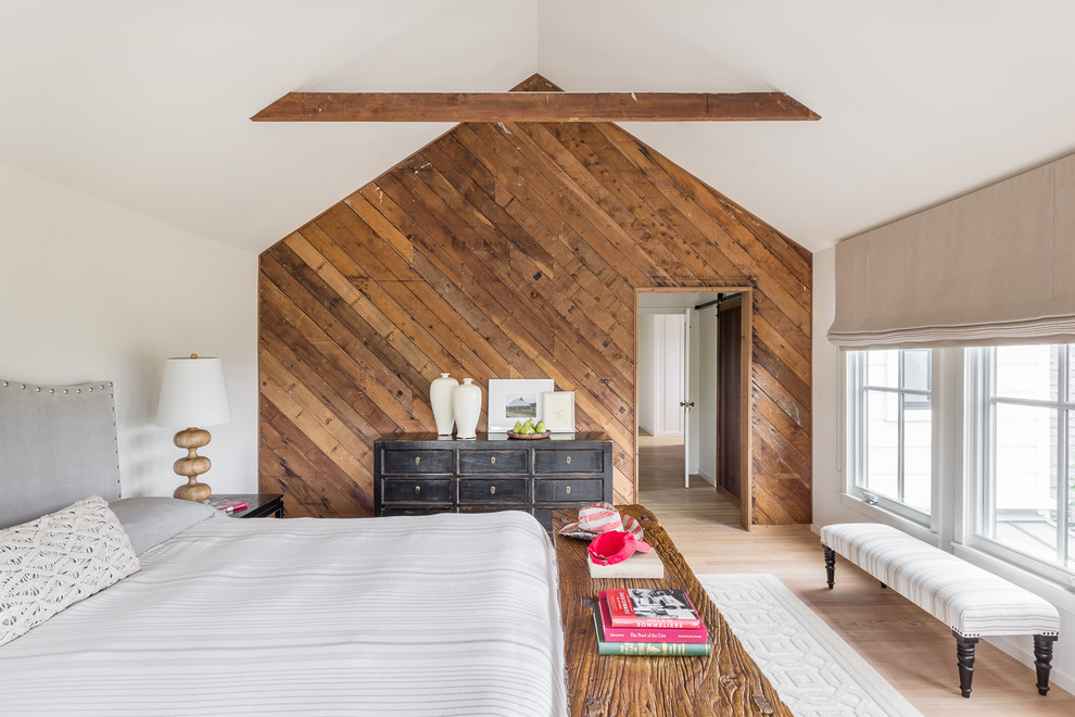 Inspiration for a farmhouse light wood floor and beige floor bedroom remodel in San Francisco with white walls and a standard fireplace