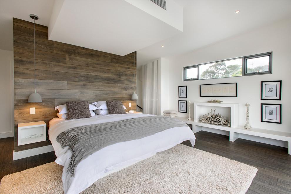 Bedroom - contemporary dark wood floor bedroom idea in Sydney with white walls