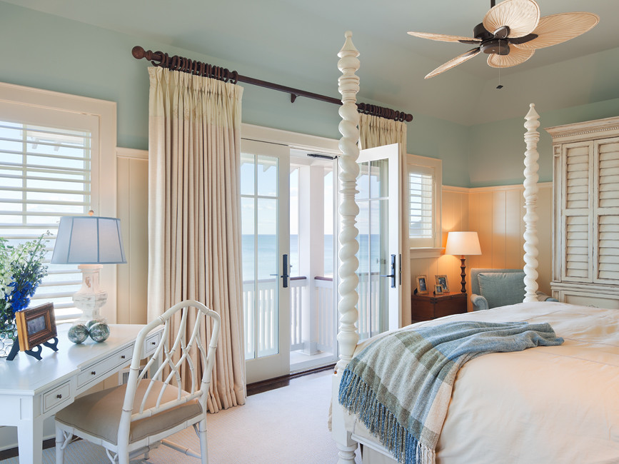 Mid-sized coastal master carpeted and beige floor bedroom photo in New York with blue walls