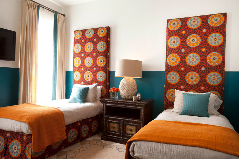 Inspiration for a mediterranean bedroom remodel in Houston with multicolored walls
