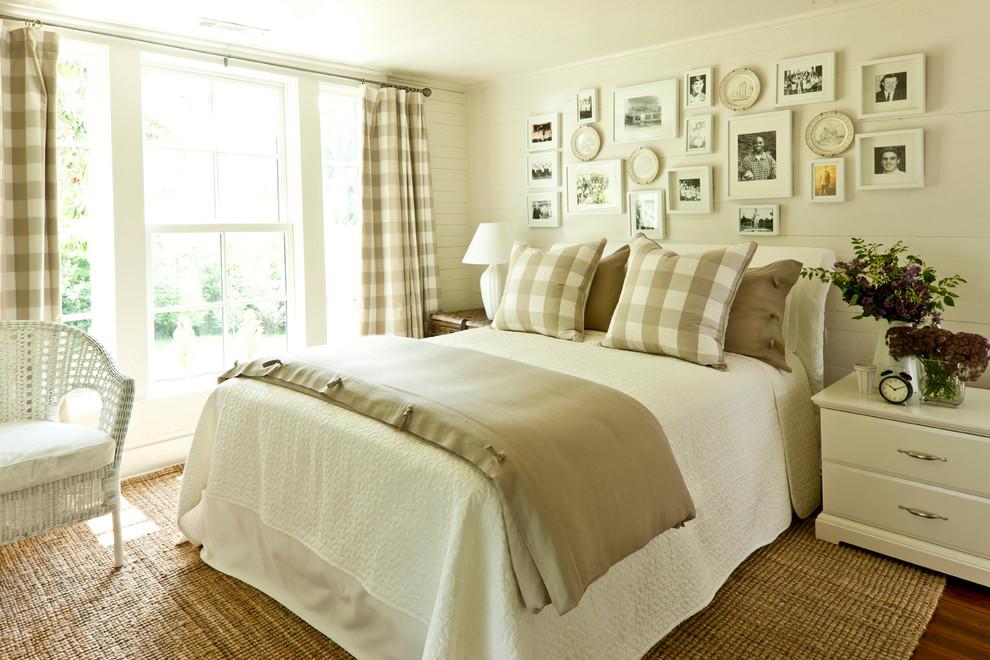 Country dark wood floor bedroom photo in Birmingham with beige walls
