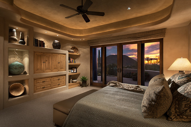 Southwest bedroom houzz inspiration for a mid sized southwestern master carpeted bedroom remodel in phoenix with beige walls mozeypictures