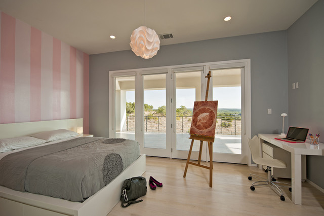 inspiration for a contemporary light wood floor bedroom remodel in austin with multicolored walls