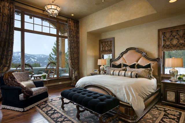 Bedroom - traditional dark wood floor bedroom idea in Other with beige walls