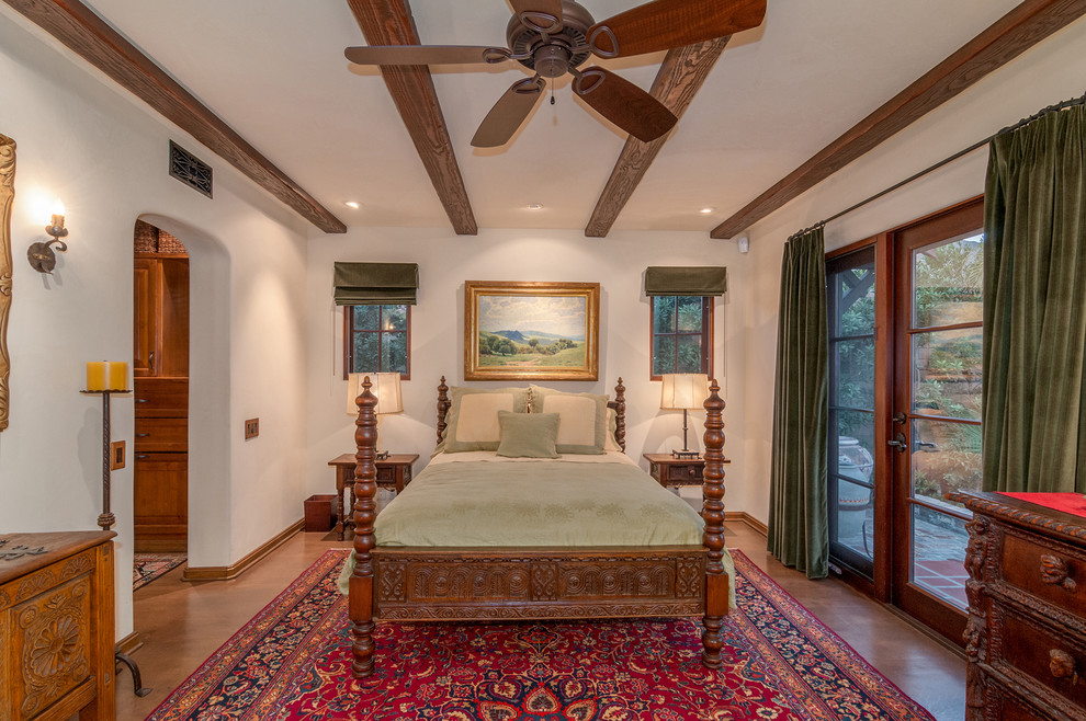 Inspiration for a mid-sized mediterranean master dark wood floor bedroom remodel in Denver with white walls and no fireplace