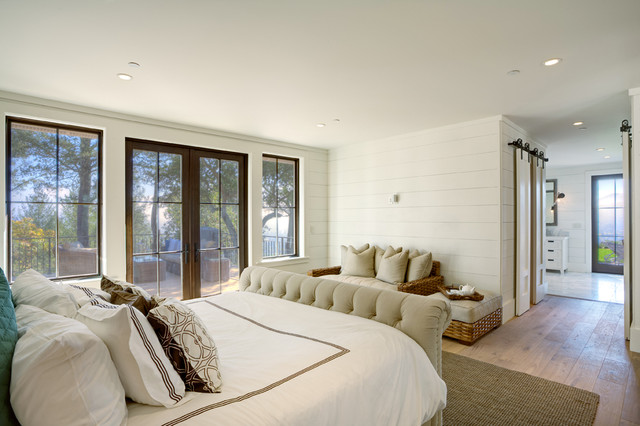 Mid-sized country master light wood floor bedroom photo in San Francisco with white walls and no fireplace