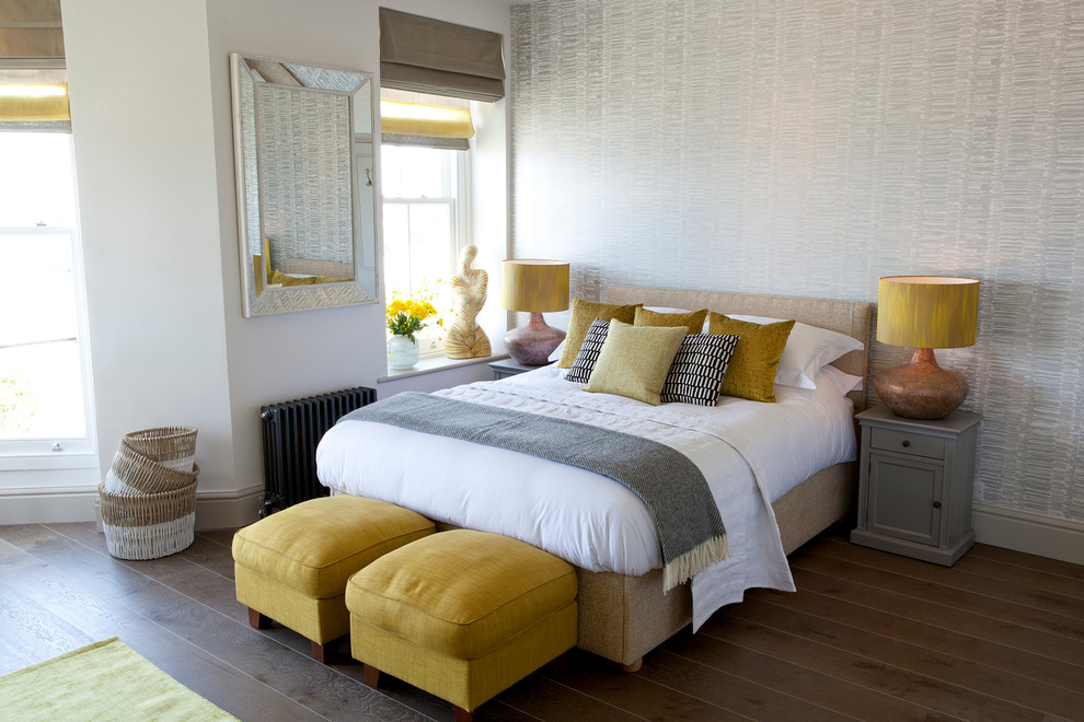 Inspiration for a coastal medium tone wood floor and brown floor bedroom remodel in Cornwall with gray walls