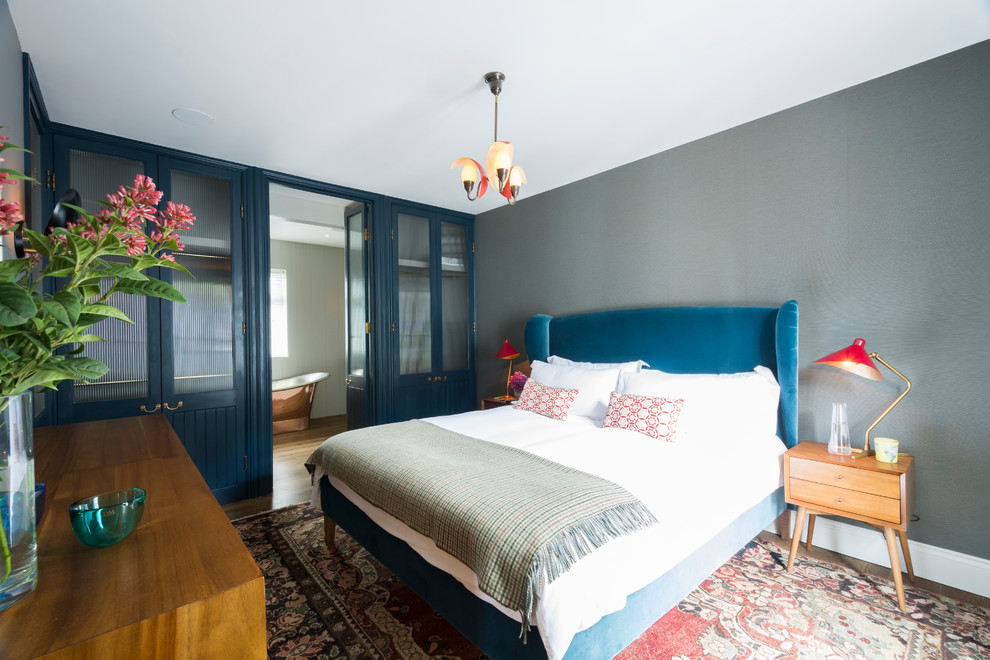 Bedroom - transitional bedroom idea in London with gray walls