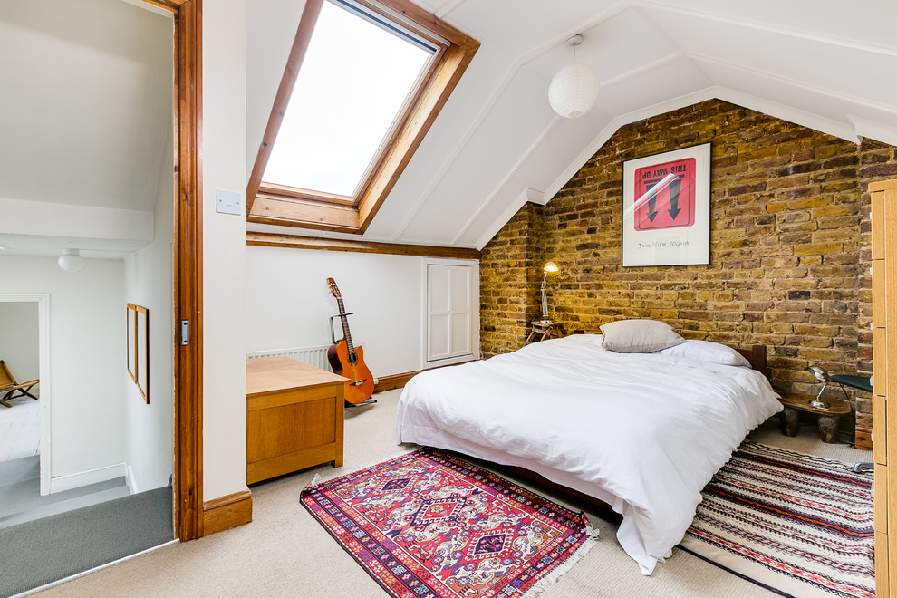 Example of a mid-sized country carpeted and beige floor bedroom design in London with white walls