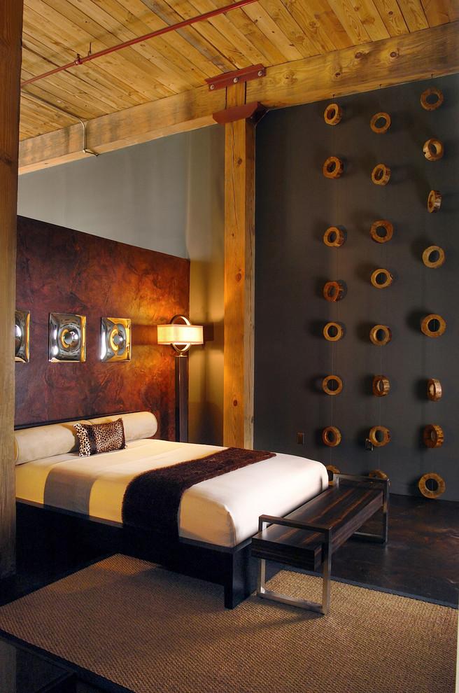 Bedroom - mid-sized contemporary master concrete floor bedroom idea in Atlanta with gray walls