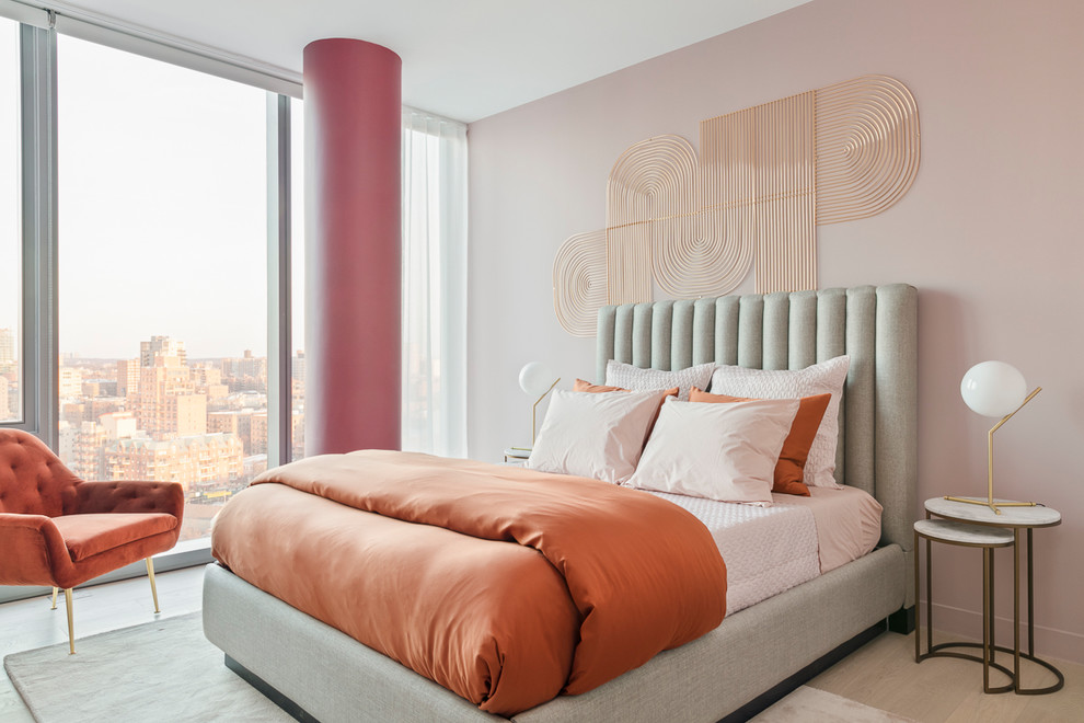 Inspiration for a mid-sized contemporary master light wood floor and beige floor bedroom remodel in New York with pink walls