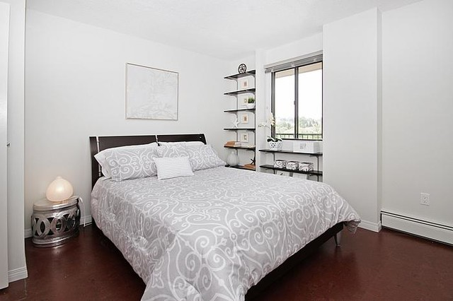 Inspiration for a small transitional master cork floor bedroom remodel in Calgary with white walls and no fireplace